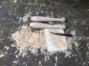 Coconut Palm shaping the clubs with a knife