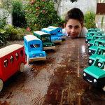 Helder Gandra Boy looking at toys